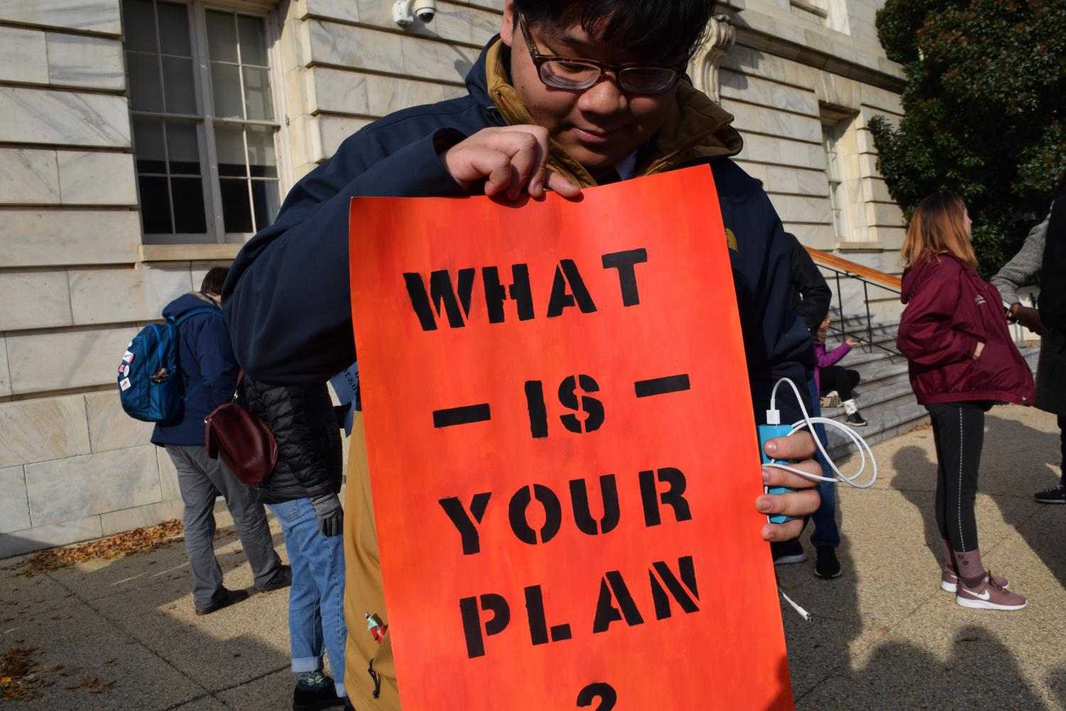 Man With A Plan - Chris Tran holds up his sign in Washington, D.C. on Dec. 10 as he prepares to lobby Congress. Photo by Francisco Mendes