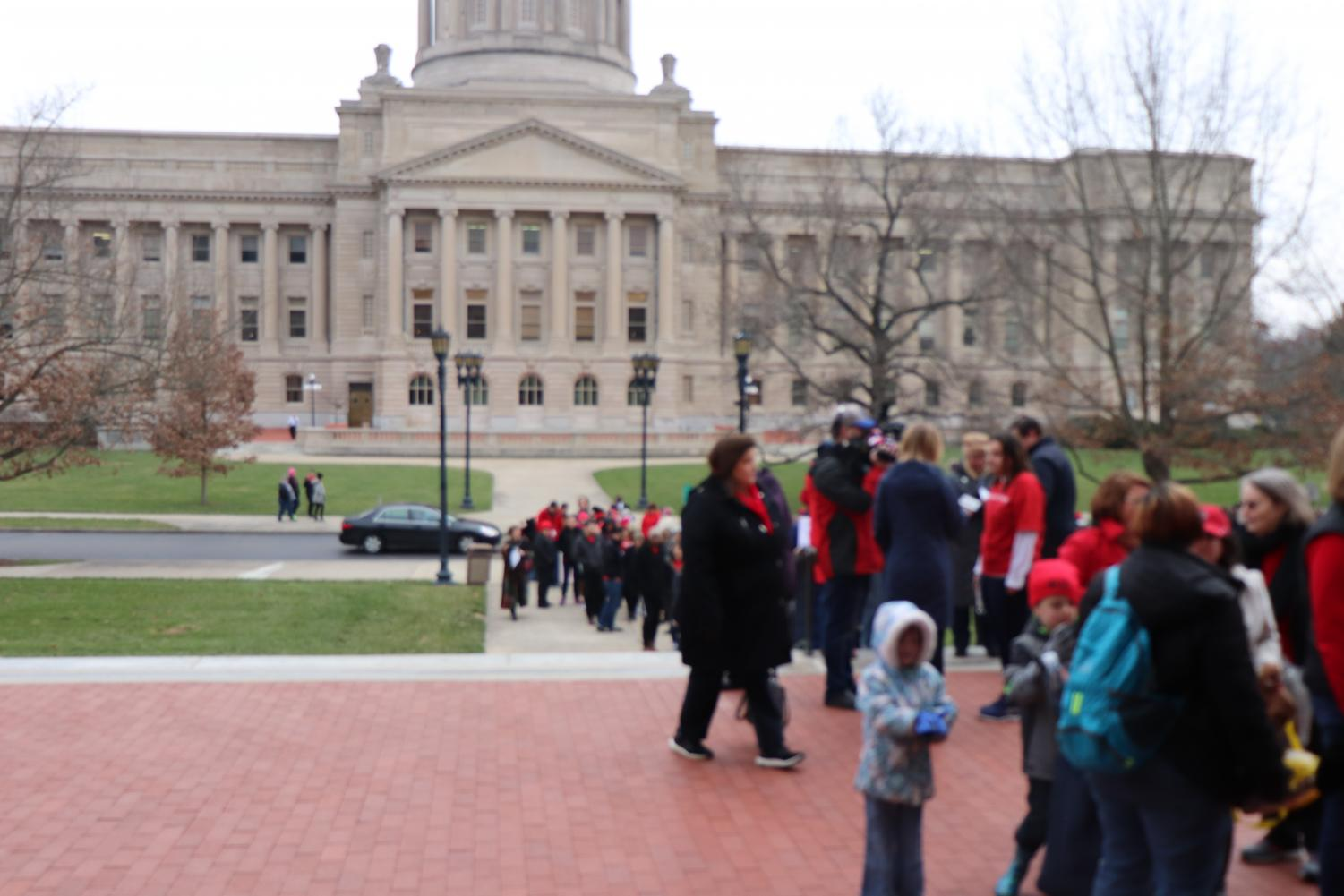 RED WAVE - Teachers line up outside the annex building of the capitol in Frankfurt, Kentucky to protest HB 525. Photo by Sylvia Cassidy