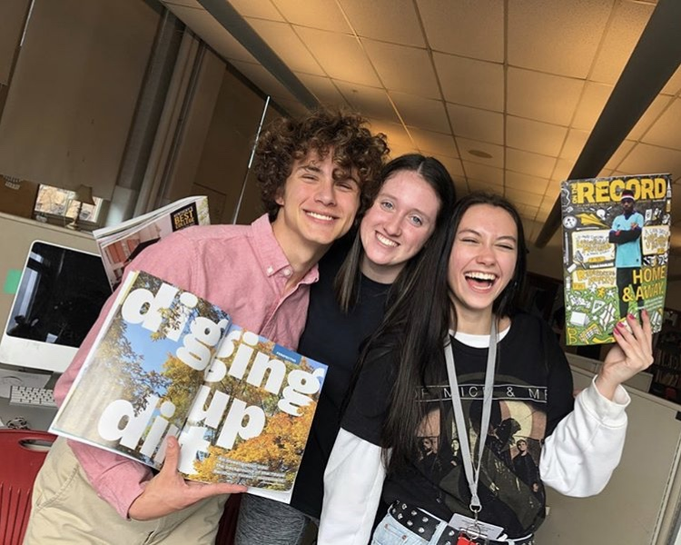John Woodhouse, Sky Carroll, and Lillian Metzmeier holding up their story for pictures as OTR's first issue arrived.