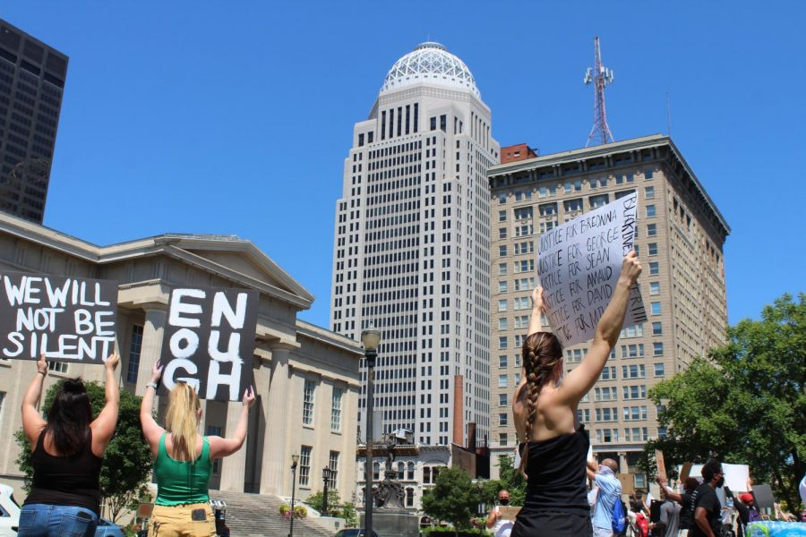 The Mercer Tower — one of Louisville's most recognizable buildings on its skyline — sits in the background as demonstrators hold up signs and chant to protest police brutality on June 2, 2020.