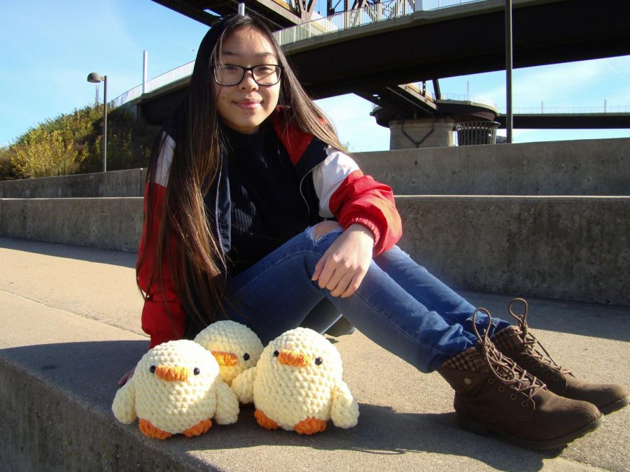 """""""Chick"""" It Out - Ashley poses behind her baby chick crochets on Nov. 18, 2020"""