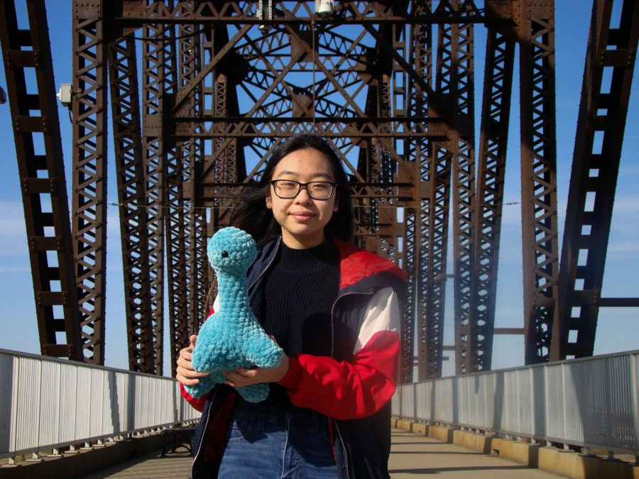Before the Bridge - Ashley stands in front of the Big Four Bridge on Nov. 18, 2020 with one of her dinosaur crochets.