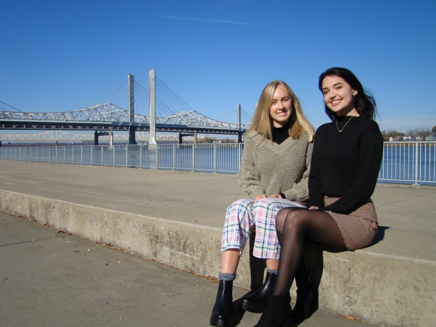 The Waterfront Park, a non-profit, public park that showcases the Ohio River and the Big Four Bridge, lies in the background as Maren and Brynna pose in bottoms from their clothing line on Nov. 18, 2020.
