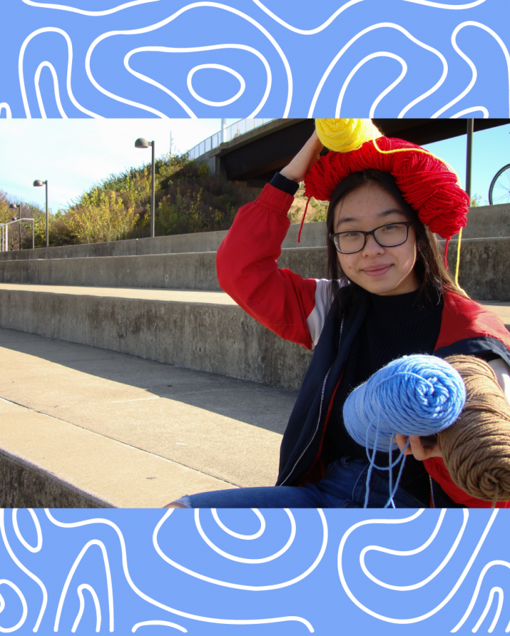 16-year-old Ashley Phan poses on the steps in front of the Ohio River on Nov. 18, 2020 with some of the yarn she utilizes for her small business.